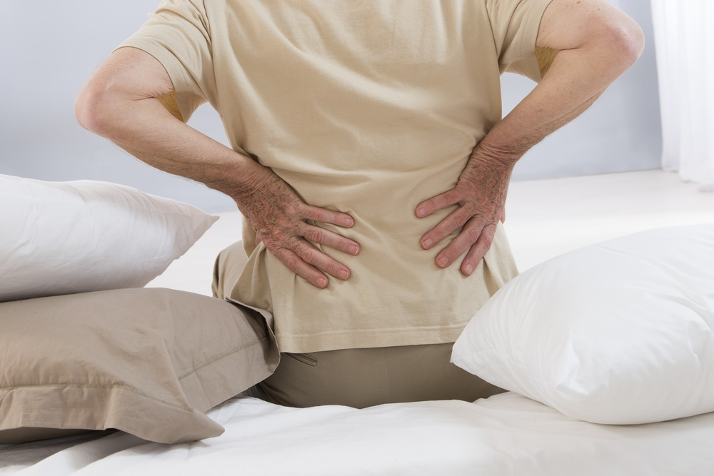 Backache: reasons and treatment